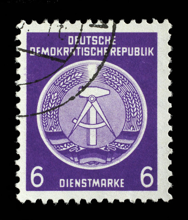 perforation: Stamp printed in GDR German Democratic Republic - East Germany shows DDR national coat of arms with inscription Service Stamp, series GDRs national coat of arms, circa 1952