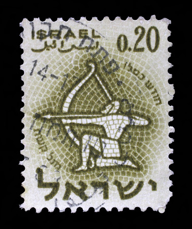 twelve month old: Stamp printed in the Israel, shows sign of the zodiac Sagittarius, circa 1961 Stock Photo