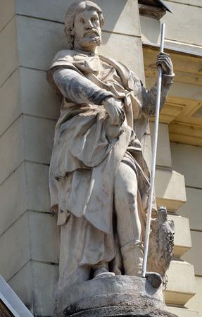 evangelist: Saint John the Evangelist on the portal of Saint James church in Ljubljana, Slovenia on June 30, 2015