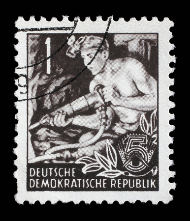 east of germany: Stamp printed in GDR German Democratic Republic - East Germany shows a Hauer without the inscription, from the series Workers For The Five-year Plan, circa 1953