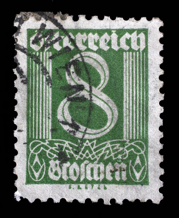 mediaval: Stamp printed in Austria shows image of the number 8, circa 1925.
