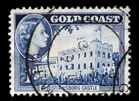 ii: Stamp printed in Ghana shows Christiansborg Castle and queen Elizabeth II, circa 1957