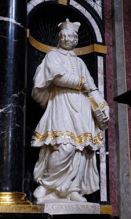 borromeo: The statue of the Saint Charles Borromeo on the altar in the Franciscan Church of the Annunciation on Preseren Square in Ljubljana, Slovenia on June 30, 2015