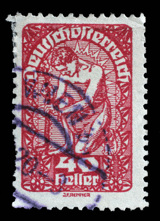 allegory: Stamp printed in the Austria shows Man, Allegory of New Republic, Austria, circa 1919 Stock Photo
