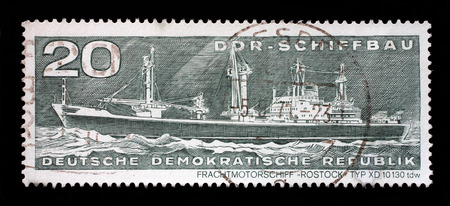 typ: Stamp printed in GDR from the GDR Ship Building issue shows Container Cargo Ship Rostock Typ XD 10130 tdw, circa 1971. Stock Photo