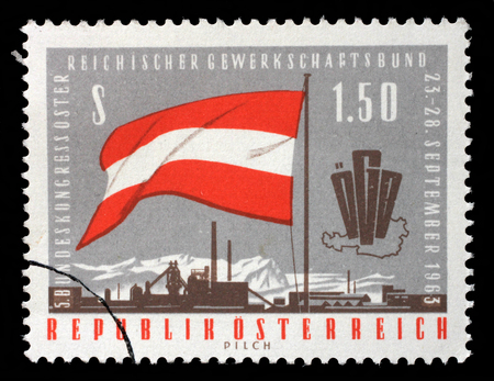 A stamp printed in Austria, devoted to the 5th Congress of the Austrian Trade Union Federation, shows a flag, emblem, map, factory, circa 1963 Stock Photo