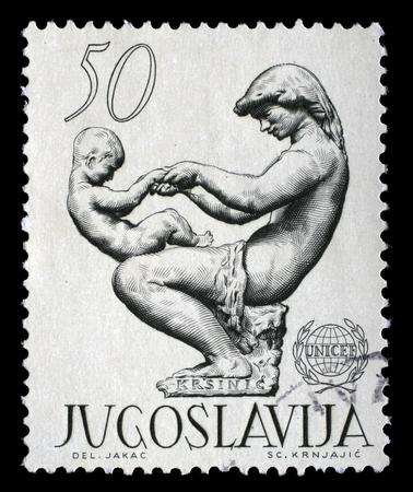 unicef: Un timbro stampato in Jugoslavia mostra il 15 � anniversario dell'UNICEF, circa 1962.
