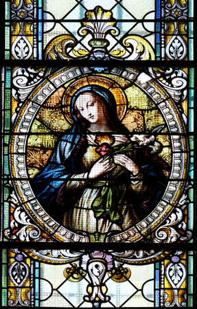 immaculate: Immaculate heart of Mary, stained glass window in Cathedral of St Nicholas in Novo Mesto, Slovenia on June 30, 2015