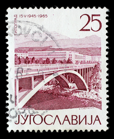 Stamp printed by Yugoslavia shows TitogradPodgorica, The 20th Anniversary of Liberation issue, circa 1965.