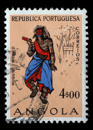 Stamp printed in the Angola shows Natives, Angolans Muquixe, circa 1957.