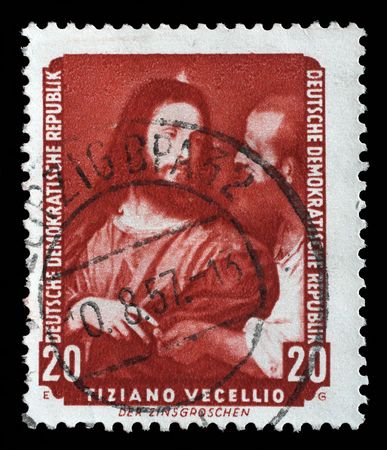 famous paintings: Stamp printed in DDR shows the painting Tax coppers, by Tiziano Vecellio , from the series Famous Paintings from Dresden Gallery, circa 1957.