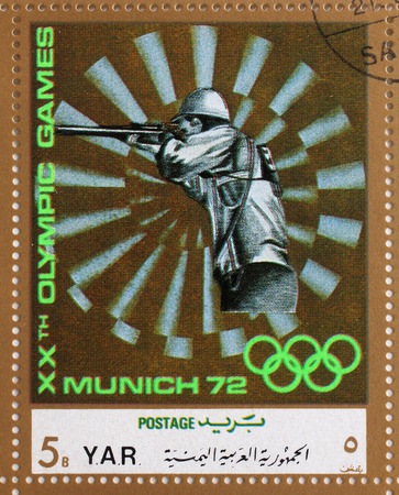 olympics: Stamp printed in Yemen Arab Republic shows sport Shooting, Olympics in Munich, circa 1972 Editorial