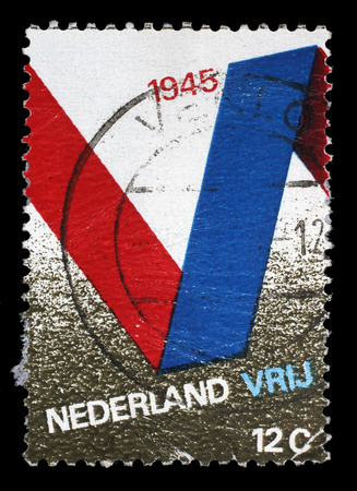stempeln: Stamp printed in the Netherlands issued for the 25th anniversary of Liberation shows V Symbol, circa 1970.