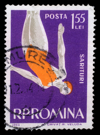 springboard: Stamp printed in the Romania shows Woman Diver, Jumping into Water from Platform, circa 1963 Editorial