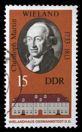 postmail: Stamp printed in the DDR East Germany shows Christoph Martin Wielandand and his house in Ossmannstedt, circa 1970s