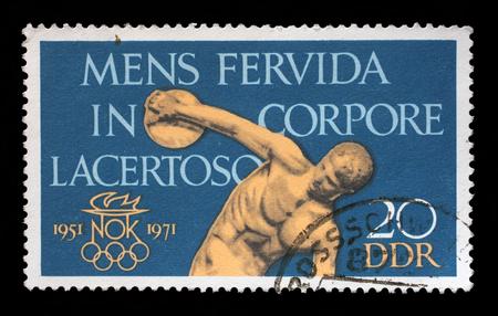 poststempel: Stempel gedruckt in DDR zeigt den 20. Jahrestag der DDR des Olympischen Komitees, Discobolus, ein feuriger Geist in einem muskulösen Körper, circa 1971