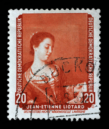 famous paintings: Stamp printed in DDR shows the painting Portrait of Mademoiselle Lavergne, by Jean Etienne Liotard, from the series Famous Paintings from Dresden Gallery, circa 1957.