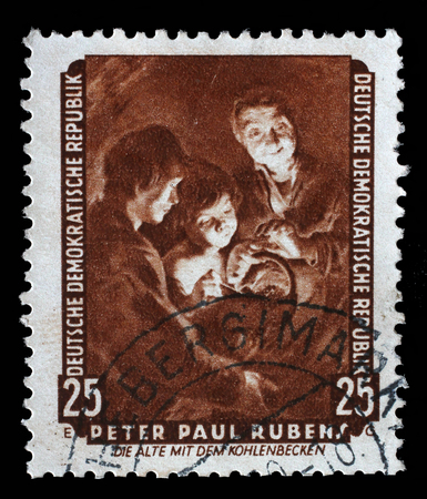 famous paintings: Stamp printed in DDR shows the painting Old woman with a brazier, by Peter Paul Rubens, from the series Famous Paintings from Dresden Gallery, circa 1957.