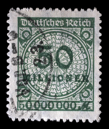 Reich: Stamp printed in the Federal Republic of Germany shows image of hyper inflated numbers, series, circa 1932 Editorial