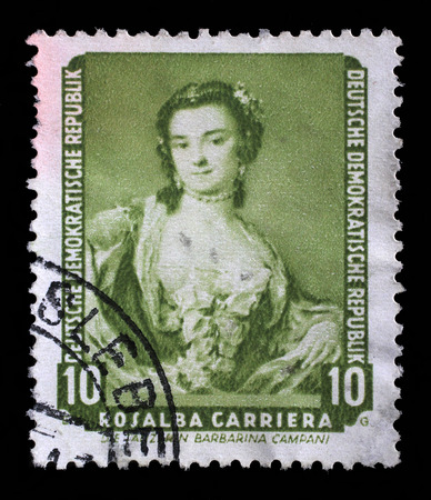 famous paintings: Stamp printed in DDR shows the painting Portrait of the dancer Barbarina Campani, by Rosalba Carriera, from the series Famous Paintings from Dresden Gallery, circa 1957.