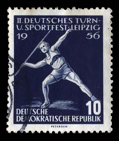 Stamp printed in GDR shows javelin throwers, Second Sports Festival, Leipzig, circa 1956 Editorial