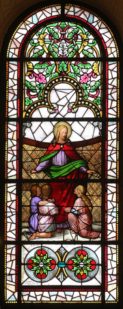zagreb: Jesus friend of children stained glass window in the Church of St. Vincent de Paul in Zagreb, Croatia on November 08, 2014 Editorial