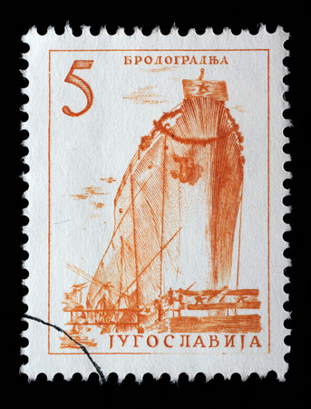 yugoslavia federal republic: Stamp printed by Yugoslavia, shows a ship in a shipyard, series, circa 1958