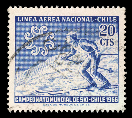 aerea: Stamp printed in Chile from the World Skiing Championships - Chile 1966 issue shows Skier crossing slope, circa 1965. Editorial