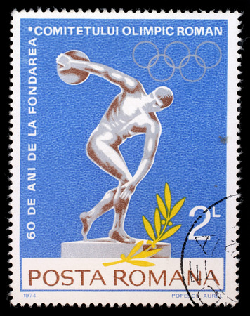 olympic symbol: Stamp printed by Romania, shows Discobolus and Olympic rings, circa 1974
