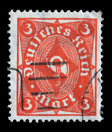 stempeln: Stamp printed in Germany shows a posthorn, circa 1921.