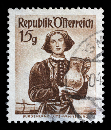 Stamp printed in Austria shows image woman in national Austrian costumes, Burgenland, Lutzmannsburg, series, circa 1948