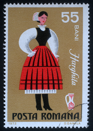 bani: Stamp printed in Romania shows image of a Harghita woman, from the regional costumes series, circa 1973