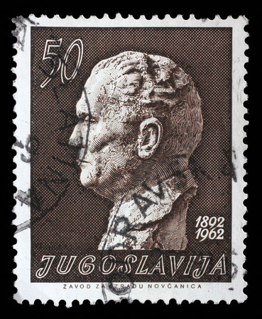Stamp printed in the Yugoslavia shows Marshal Tito by Augustincic, Josip Broz Tito, 1st President of Yugoslavia, circa 1962 Editorial