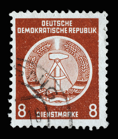 east germany: Stamp printed in GDR German Democratic Republic - East Germany shows DDR national coat of arms with inscription Service Stamp, series GDRs national coat of arms, circa 1952