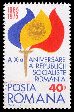 socialist: Stamp from Romania shows Torch with Flame in Flag Colors and Coat of Arms, commemorating 10th anniversary of Romanian Socialist Republic, circa 1975