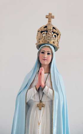 francis: Our Lady of Fatima statue in the Church of Saint Francis of Assisi in Lipik, Croatia on May 07, 2015