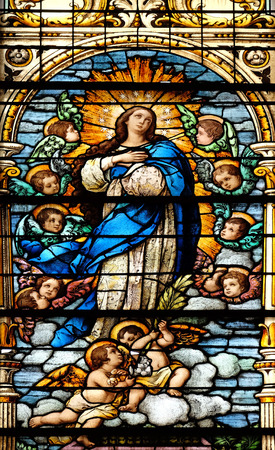 church window: Assumption of the Virgin Mary, stained glass window in the Basilica of the Sacred Heart of Jesus in Zagreb, Croatia Stock Photo