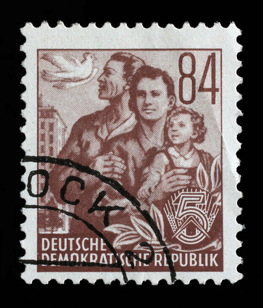 gdr: Stamp printed in GDR, shows a family, series Five-year plan