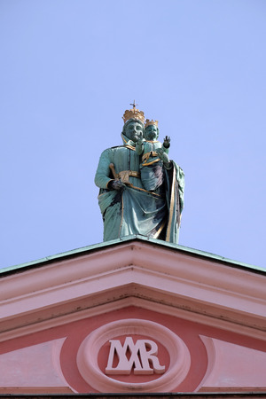 jesus standing: Madonna and Child at the top of the Franciscan Church of the Annunciation in Ljubljana, Slovenia