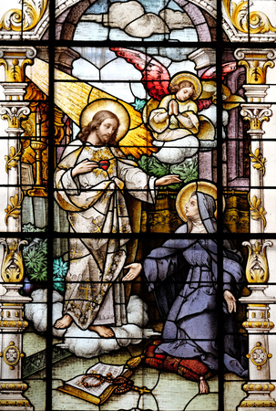 church window: Jesus and Saint Margaret Mary Alacoque, stained glass window in the Basilica of the Sacred Heart of Jesus in Zagreb, Croatia