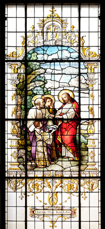 The Multiplication of the Loaves and Fish, stained glass window in the Basilica of the Sacred Heart of Jesus in Zagreb, Croatia Editorial