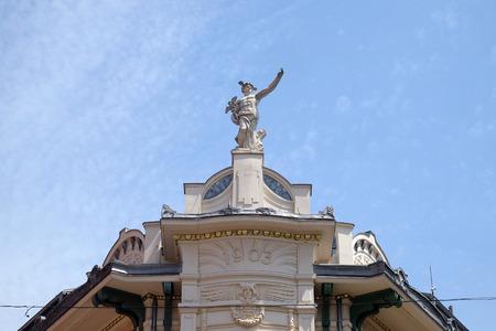 emporium: Mercury, the Roman God, at the top of the Galeria Emporium, former Mercure Center 1903, Ljubljana, Slovenia