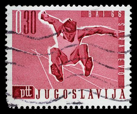 salto de longitud: Sello impreso por Yugoslavia muestra Salto de longitud, Juegos de los Balcanes en Sarajevo, alrededor del año 1966.
