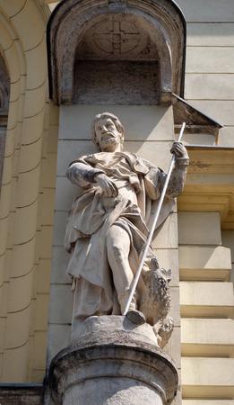 evangelist: Saint John the Evangelist on the portal of Saint James church in Ljubljana, Slovenia