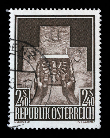 un used: Stamp printed in the Austria shows Symbolic of Austrias Admission to the UN, circa 1956 Stock Photo