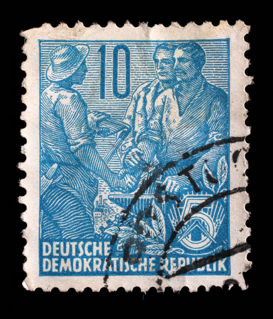 gdr: Stamp printed in GDR, shows Farmer, worker, intellectuals, series Five-year plan, circa 1955 Stock Photo