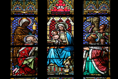 lamb of god: Nativity Scene, Adoration of the Magi, stained glass window in parish church of Saint Mark in Zagreb, Croatia