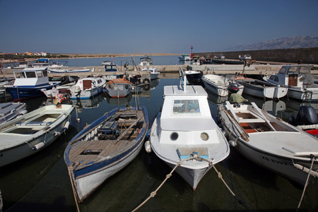 touristic: Old boats in harbor at Adriatic sea. Vinjerac, Croatia, popular touristic destination Editorial