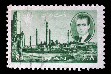 mohammad: Stamp printed in Iran shows Shah Mohammad Reza Pahlavi, on background of ruins of Persepolis, capital of ancient Persia, destroyed armies of Alexander of Macedon, 1966