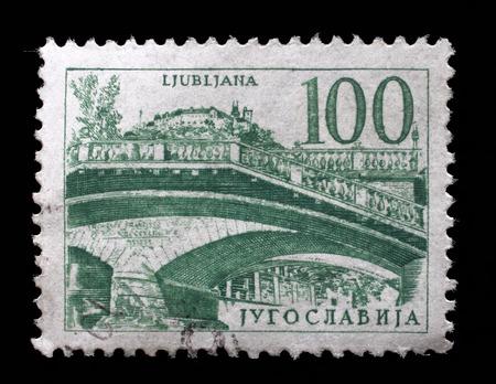 yugoslavia: Stamp printed in Yugoslavia shows Triple bridge, Ljubljana, circa 1958 Stock Photo